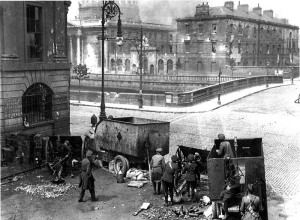 Troops of the new Irish government use British-lent cannon to shell Republican HQ in the Four Courts in 1922, starting the Civil War.