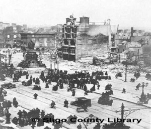 O'Connell St (then Sackvill St) from the Bridge looking north-eastwards.  Destruction by bombardment of a major UK city shows determination of the British to crush the Rising.