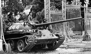 Vietnamese liberation forces tank crashes through the gates of the US Embassy in Saigon as liberation forces take the city from the US puppet regime after US forces left