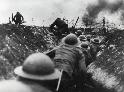 British soldiers move up through a trench at the Somme battle, Northern France, to begin attack, WWI