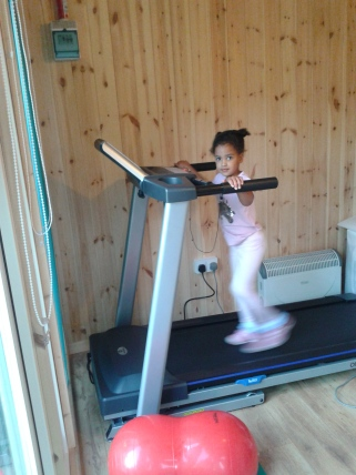 Caitlin Rose on her daily exercise treadmill