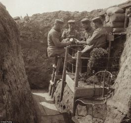 German soldiers playing cards during WWI. Photos of Germans in WWI more readily available show them wearing masks and looking like monsters.