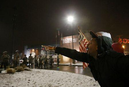 A protester shouts at the National Guard standing on duty outside the Ferguson Police Department after the grand jury verdict in the Michael Brown shooting in Ferguson, Missouri, November 26, 2014. (photo: REUTERS/Jim Young)