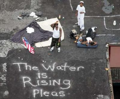 Hurricane Katrina victims in New Orleans signaling for help