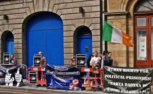 Information picket (with table across the road) organized by Anti-Internment Group of Ireland in September 2014 at Thomas St./ Meath St. junction, Dublin. They returned there in December and in January supported a picket in Cork, handing out leaflets on the Craigavon Two injustice.