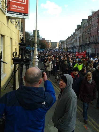 Parnell Square West from Granby Place.  The front of the march has turned into Dorset Street and is marching there but the end has yet to come around the corner into the square from Parnell Street
