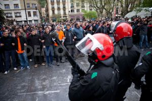 Basque Police, the Ertzainta, face youth Solidarity Wall with a Basque comrade the police have come to arrest in Donosti/San Sebastian some years ago.
