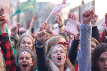 """Small section of crowd in large """"Dearg le Fearg"""" (Red with Rage) demonstration March 2014 about lack of support for the irish language."""