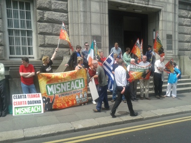 Part of a recent lunchtime demonstration outside the office of the Department responsible for the Gaeltacht.  It was called by a new incarnation of Misneach, an organisation active in the mid-1960s.
