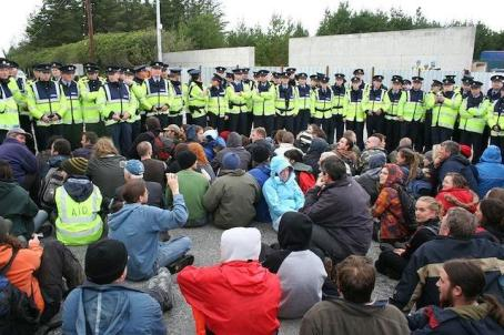 Gardai defending Shell confront protesters