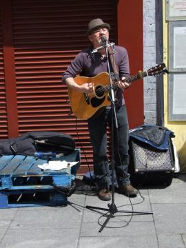 "Paul O'Toole, who played a number of sets at an ""Arms Around Moore Street event in June 2015, including singing some songs of his own composition. The event was organised by Save Moore Street From Demolition group."