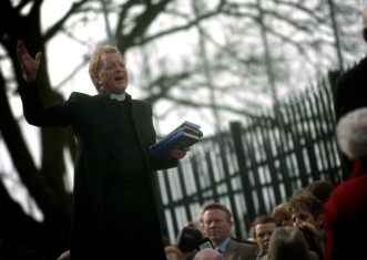 Dr David Latimer, First Derry Presbyterian Church, conducts a redediication ceremony on Derry's Walls. Photo: Stephen Laitmer