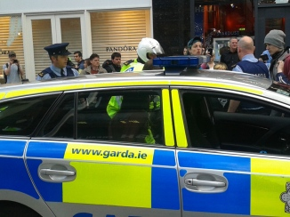Some in crowd beginning to argue with Gardaí as others look on amazed