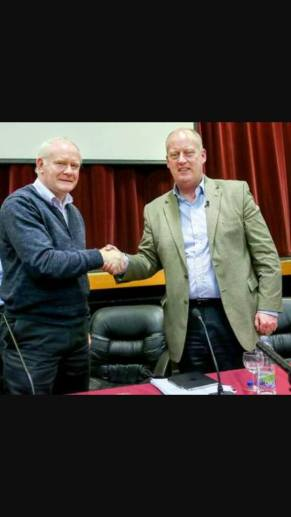 Mc Guinness posed shaking hands with the Chief Constable of the PSNI at a public meeting earlier in the week at a Falls Road venue