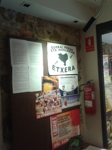 Posters and information on the Herriko wall near the front of the bar area