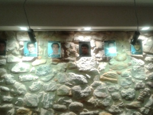 Portraits of local activists in jail prominently displayed on the wall in the bar area of the Herriko