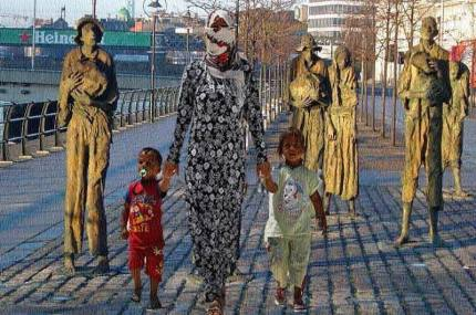 Famine emigrants monument on the north quays of the river Liffey, Dublin, with superimposed image of African woman and children. Image from Memet Uludag on Facebook.
