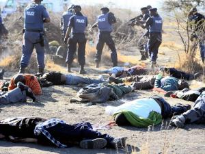 The Marikana Massacre of striking miners by the South African police of the ANC government. The victim in a green top or blanket is believed to a Mgcineni Noki, a strike leader, who was shot 14 times.