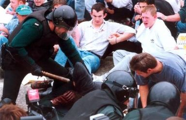 People protesting Loyalist marches on Garvaghy Road being attacked by the PSNI in 19977