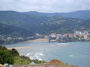 Mundaka coastline in Bizkaia province on south-eastern coast -- with mountains visible behind