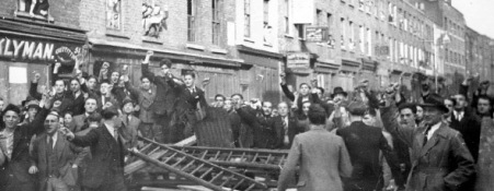 Barricade against a Blackshirt march at Cable Street, East London, 1936. The attack was spearheaded by the police but the antifascists were successful.