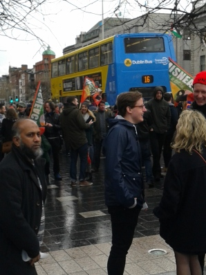 Small section of crowd on east pavement, O'Connell St, with Misneach organisation flags visible (Photo D. Breatnach)