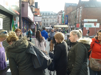 December 2014, crowd signing the petition in Moore Street, Brónagh at the table