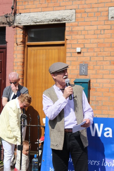 "Diarmuid Breatnach singing ""Felons of Our Land"" outside former home of Walter Carpenter. (Photo East Wall History Group)"