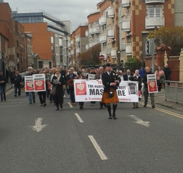Lone piper leading march from Stoneybatter along North Brunswick Street