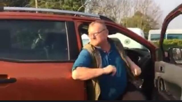 Mr. 'Rowdy' Nolan leaving his car after backing into Mr. McGrath and just before his foray into the protesters.