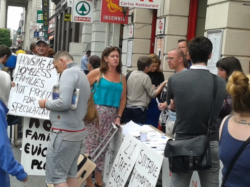 Supporters and members of the public at campaign table outside Lynam Hotel during the week