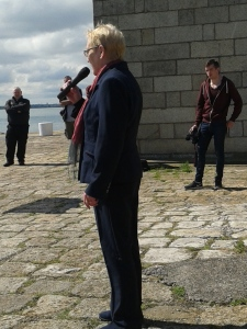 Margaret McKearney speaking and chairing the occasion on the pier