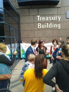 Families and supporters confronting NAMA PR representative Martin Whelan (in blue suit) (Photo: D. Breatnach)