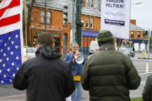 Jean-Ann speaking at picket on the US Embassy in Dublin in solidarity with Leonard Peltier. The photographer's back is to the Embassy.