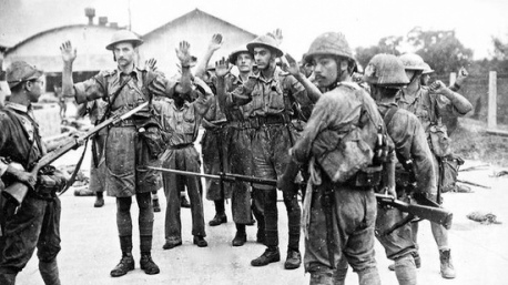 British soldiers surrendering to Japanese Army at the Surrender of Singapore 1942.