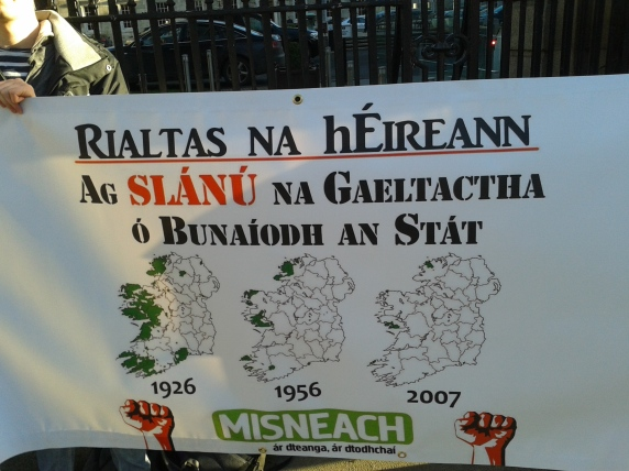Map on Misneach banner illustrates the decline of areas where Irish is a living community language under the Irish state's administration. (Photo D.Breatnach)