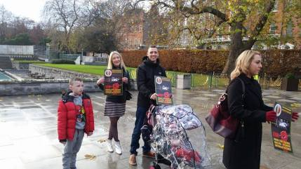 Family of supporters leaving Garden of Remembrance ad tail end of march