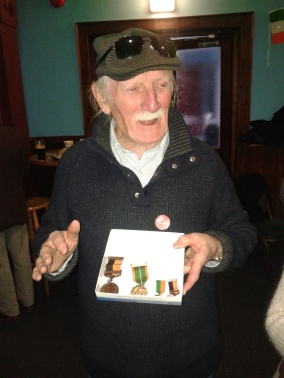 Joe Kelly displaying his father's 1916 service medal at a 1916 commemoration event (photo: D.Breatnach)