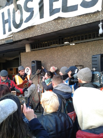 """Rosie Leonard relaying court decision to cries of """"Shame1"""" and chants of """"We shall not be moved!"""""""