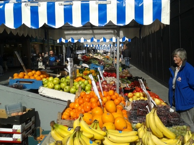 Some of the few surviving fruit stalls on Moore Street, half-way down the main stall street, east side, looking northwards. (source: D.Breatnach)