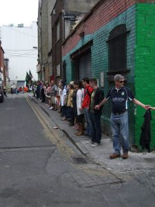 """Corner of Henry Place (centre) and Moore Lane (right) looking westward towards Moore Street (photo taken by supporter during """"Arms Around Moore Street"""" event in June 2015)"""