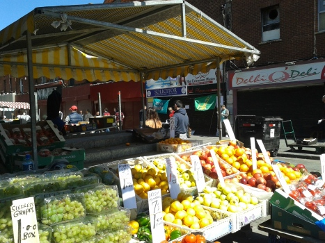 View of the campaign table through fruit stall on a sunny Saturday in Moore St in June 2015 (Photo D.Breatnach)